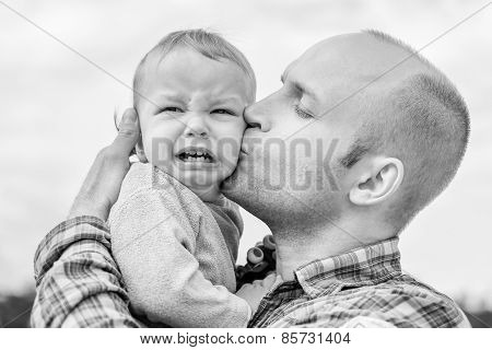 Caring Father Calms Toddler Son Outdoors