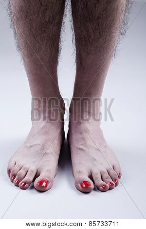 Man's Feet with Red Nail Polish
