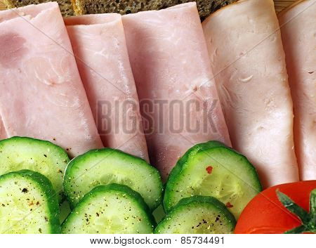 Tasty breakfast - tomatoes, cucumber, ham and bread