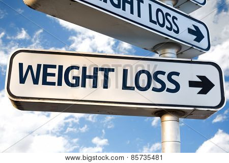 Weight Loss direction sign on sky background
