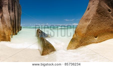 Landscape Seychelles lagoon with clean sand with stones