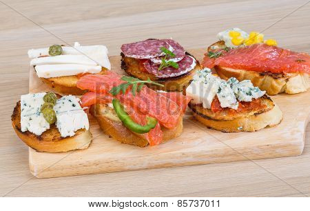 Tapas With Cheese, Salami And Salmon