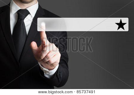 Businessman Pushing Button Black Star
