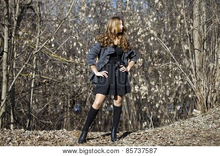 Young beautiful girl, on background spring forest