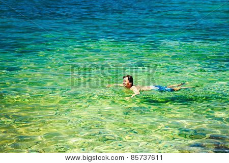 Man Swiming in Crystal Clear Sea