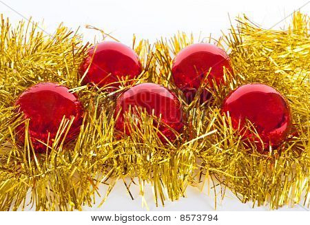 Red Christmas Balls On Gold Tinsel
