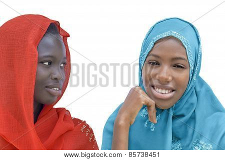 Two Afro beauties wearing a veil, isolated