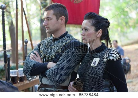 ZAGREB, CROATIA - OCTOBER 07, 2012: Man and woman dressed in medieval knight clothes at