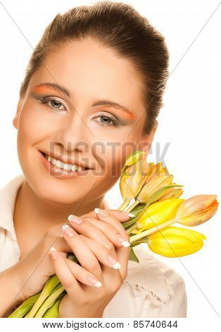 happy woman with yellow tulips