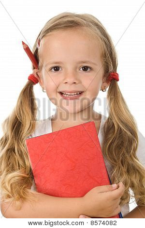 Little Schoolgirl Portrait With Books And Pencil