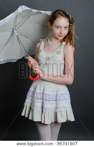 Girl In A Linen Sundress With Sun Umbrella