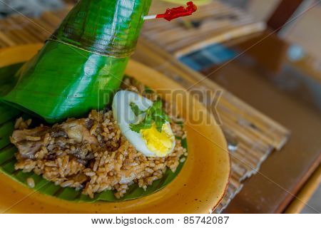 garlic rice in coconut leaf served in small tropical restaurant