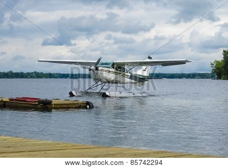 Float plane landing on a lake, Canada