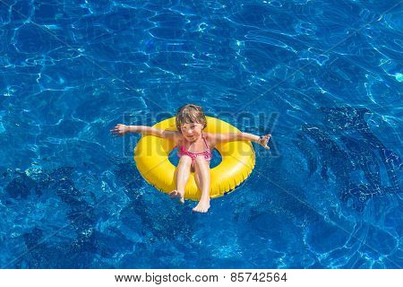 young happy child girl having fun on tropical background, kid enjoying summer vacations, beach holidays