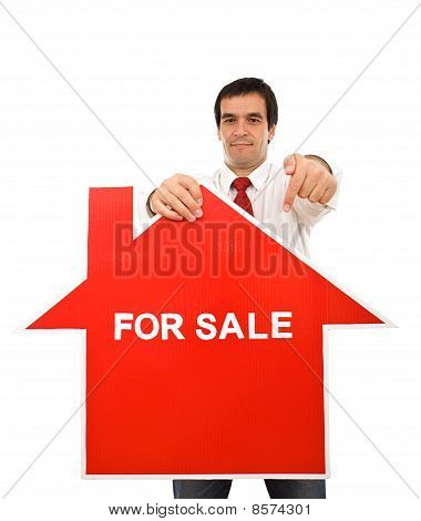 Real Estate Concept With Agent Showing Sign