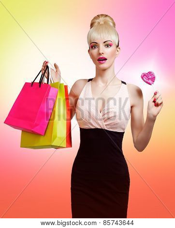 Woman holding shopping bag isolated on colorful background