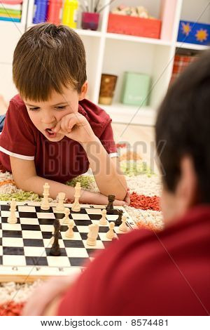 What Should I Do Now - Kid Playing Chess Thinking