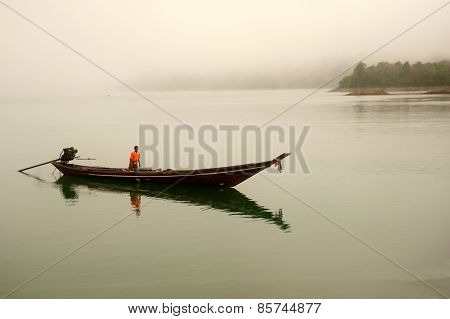 Traditional Boat Waiting Tourists In Cheow Larn Lake,Thailand.