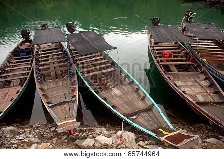 Traditional Boat Waiting Torists In Cheow Larn Lake,Thailand.