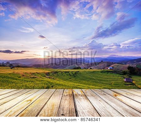Perspective View To Paddy Green On Sunset Sky Background And Wood Floor Texture,chiang Mai, Thailand