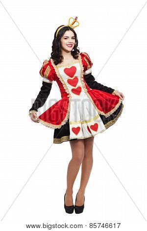 Queen of hearts. Creative young lady in black and red colors dress