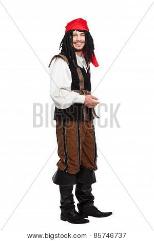 Smiling funny man dressed as a pirate with dreadlocks isolated on white