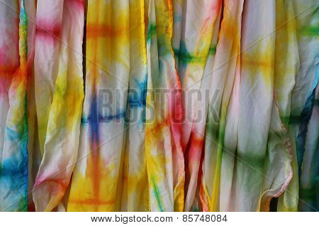 Silk background in vibrant colors of the rainbow.