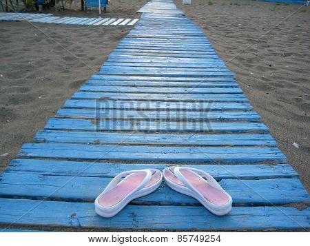 Flip-flops On The Beach.