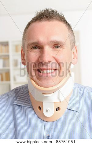 Smiling man with a surgical cervical collar