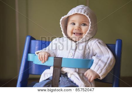 Cute Baby Girl In A Blue Chair