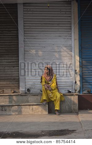 Woman Sitting On The Streets