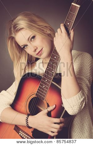 Portrait Of Young Blonde Female Guitar Player