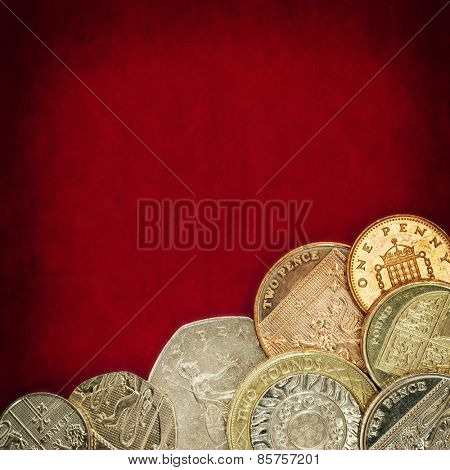 British coins over red grunge background.