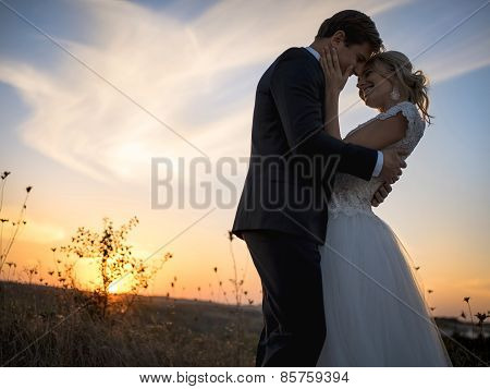 Silhouette of wedding couple in love