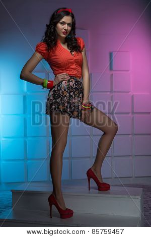 Portrait of sexy dressed in bright clothes brunette