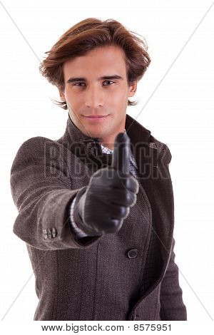 Portrait Of A Young Businessman With Thumb Up, In Autumn/winter Clothes, Isolated On White. Studio S