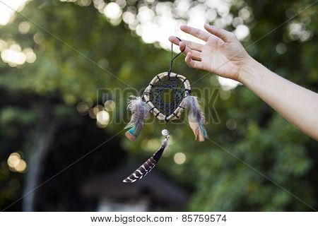 Woman holding dream catcher in nature