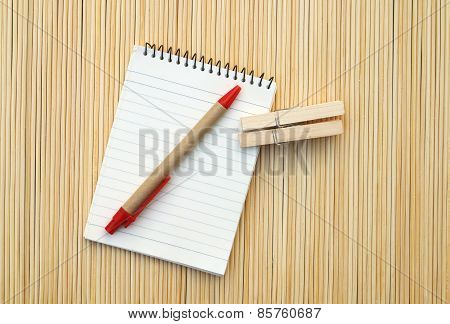 Pen And Notepad On Bamboo Matt
