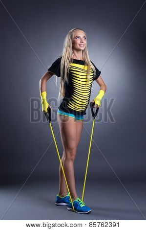 Image of smiling woman exercising with expander