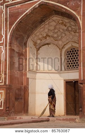 Indian Woman Sweeping Floor Of Humayun's Tomb, Delhi, India