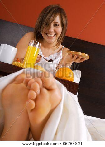Woman In Bed Heaving Breakfast