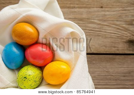 Five Easter Eggs On White Napkin