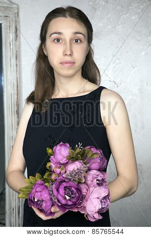 Portrait of a young Caucasian woman with purple flowers