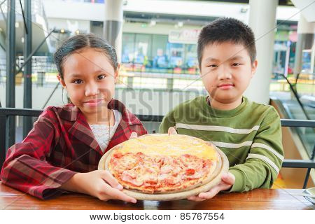Child Hold Pizza