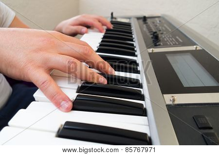 closeup photo of a person's hands playing piano