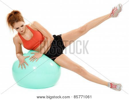 Athletic Woman Exercising With Gym Ball