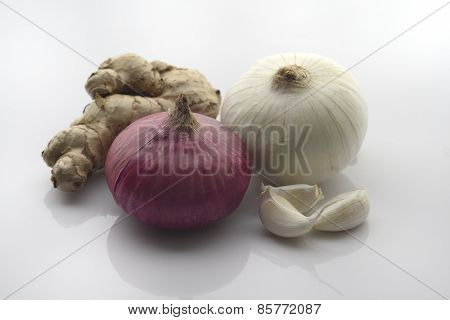 Ginger, Garlic cloves with Red and White Onion