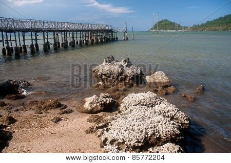 The Traditional Wooden Long Bridge Over The Sea,Thailand.