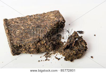 black pu-erh chinese tea  a white background