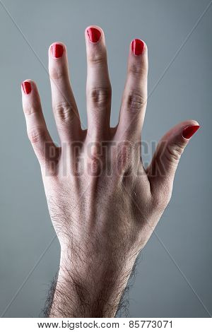 Man's Hand with Red Nail Polish